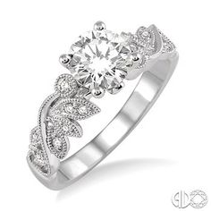 1/2 Ctw Diamond Engagement Ring with 1/3 Ct Round Cut Center Stone in 14K White Gold www.christensenjewelers.com