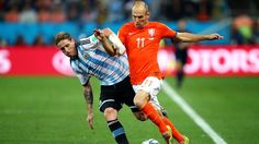 Lucas Biglia of Argentina and Arjen Robben of the Netherlands compete for the ball