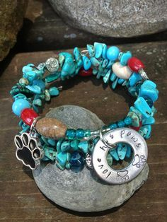 Love Has Paws: dog lover  three wrap memory wire beaded bracelet with metal stamped charm on Etsy, $30.00