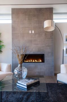 Grey stone modern fireplace remodel modern Best Amazing Fireplace Tile Ideas for Your Living Room - homelovers remodel stone Fireplace Tv Wall, Grey Fireplace, Wall Mount Electric Fireplace, Fireplace Remodel, Living Room With Fireplace, Fireplace Surrounds, Living Room Decor, Fireplace Modern, Fireplace Ideas
