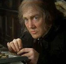 'Scrooge', 1970 - Albert Finney as Ebenezer Scrooge. In this musical version of Dickens' classic novel; Albert Finney is at first unrecognizable in his stooped & balding demeanor. When he ventures with the Ghost of Christmas Past; we see a young, dashing & handsome Scrooge. We see how over the years he amasses his fortune; but looses the love of his life, then becomes the famous, embittered old miser. It isn't until his journey with the 3rd ghost; that he experiences true self redemption.