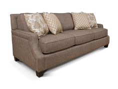 You can't put just any furniture in a well designed home… Take a look at the upscale simplicity of the Haynes collection from England. Featuring an impeccably welted side arm panel, cut away track arm, exposed wood leg, and raised back panel, this group is sure to please. Make it look understated and sophisticated or bold and dazzling with your choice of over 400 fabrics.