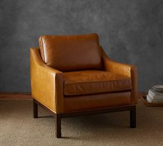 2 leather chairs paired with a fabric couch would add texture. Dale Leather Armchair