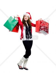 smiling young female with shopping bags looking away. - Smiling young female with shopping bags looking away over white background, Model: Brittany Beaudoin