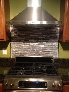 Glass and metal back splash with granite trim.