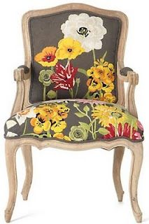 Accent chair in Dark gray with bold yellow/red/white print!