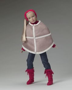 Autumn Chill (2005)  OUTFIT ONLY  LE1500   T5-M12C-00-002  $29.99      Tyler's collection of children's apparel was no different as her younger sister, Marley Wentworth™ certainly believed. This outfit favorite kept Marley warm and trendy with a faux sealskin poncho over red sweater and simple jeans…but oh, those boots! A dash of fringe made all the difference in the world to Marley, who mirrored her older sister's keen sense of casual fashion.