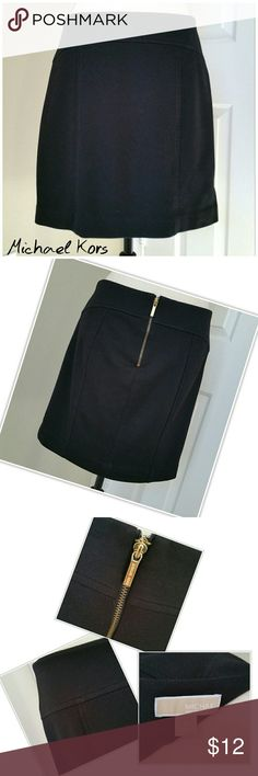 """🌆 Michael Kors Black Mini Skirt Gold Zipper Sz 8 * MICHAEL by Michael Kors black mini skirt. Gold MK zipper in back. Not lined. * Size 8 * 32"""" waist, 17"""" length  * 70% polyester, 25% rayon, 5% spandex  * Good used condition. Material has pilling from wash and wear. MICHAEL Michael Kors Skirts Mini"""