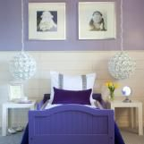 Check out this stylish purple kids room with hanging floral lamps.