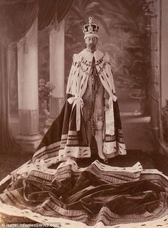 King George V of the United Kingdom wearing the Imperial Crown of India and coronation robes at his Delhi Durbar proclaiming him Emperor of India, 1911
