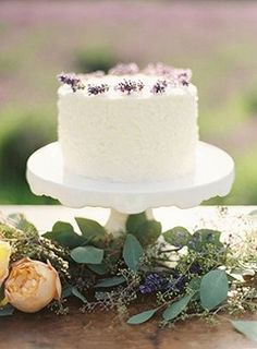 An understatedly beautiful Lavender Topped Wedding Cake. #food #lavender #wedding cake