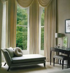Chaise in the bay window of the bedroom, with a beautiful dressing table