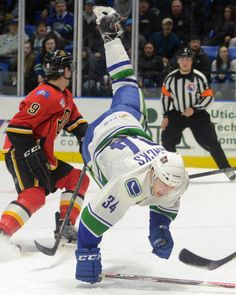 TINA RUSSELL / OBSERVER-DISPATCH:  Utica Comets player Carter Bancks falls on the ice during AHL hockey against the Adirdonack Flames at the Utica Memorial Auditorium Friday, Feb. 27, 2015.