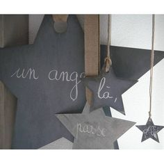 slate stars hung from leather and twine - change the chalk messages every year!