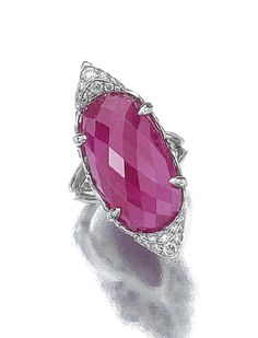 Ruby and diamond ring. Set with a briolette ruby, to the brilliant cut diamond borders, mounted in platinum