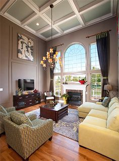 Chic colorful living room design with ivory cream walls paint color ...