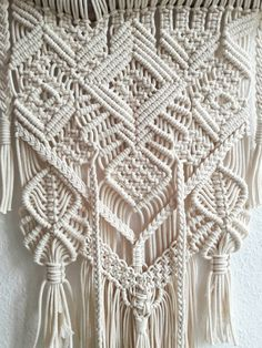 Polka_knot handmade macrame wall hanging The wall hanging is an accessory to your home and living area. It is made from different kinds of 100 % natural cotton rope, which gives a special visual effect in a sense of texture and different tones of beige/natural color. The piece contains a
