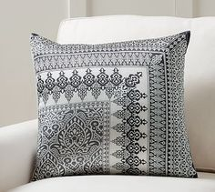 A chic monochromatic palette highlights the intricate details of this pillow cover, inspired by a vintage scarf.