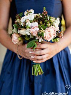 Romantic autumn bouquet of blush pink garden roses and unripe blackberries