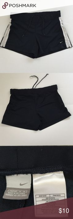 """Nike Athletic Shorts, size Medium Nike Athletic shorts in size medium. Color is a very dark blue with a white stripe on each side. Features an elasticized waist with tie. Measures 12"""" from waist to hem. Made from 100% polyester. Please ask if you have any questions. Nike Shorts"""