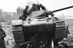 T-34/76 crushing a German gun