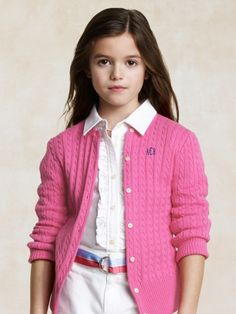 I had a cardigan very similar to this in high school...but it had silver buttons...I wish like anything that I still had it!