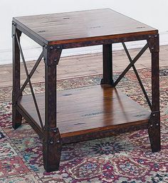 """Straddling the line between modern and refined, the Crosswinds End Table makes its home among other furnishings with ease. Imported. 24""""L x 24""""W x 24""""H. Wt: 40 lbs."""