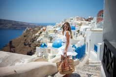 Gal Meets Glam-Santorini http://katianp2.wix.com/the-lady-in-black#!travelling-in-style/cyp0