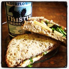 A delicious ploughmans sandwich washed down with our our 0.5% non alcoholic elderflower cider