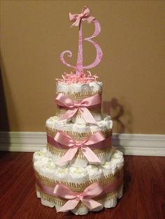 Baby girl diaper cake with pink and burlap ribbon for a diaper shower