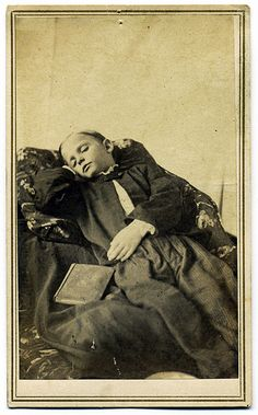 Victorian post mortem photo of a dead boy They used to pose their dead for one last photo. creepy by today's standards