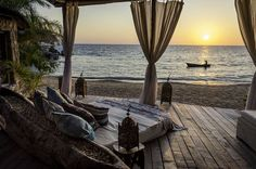 Kay Mawa, Malawi, Africa. Voted one of the best beach hotels in 2014 by Conde Nast Traveler. Doubles priced at about £400 (or $670)