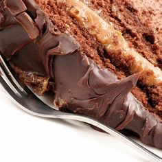 A moist chocolate cake recipe lined with gooey caramel and chocolate frosting.. Caramel Mud Layer Cake Recipe from Grandmothers Kitchen.