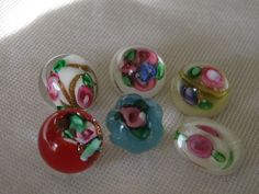 Lot of 6 ANTIQUE Petite Rose Flower Glass Paperweight BUTTONS. $29.75, via Etsy.