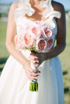 Brides.com: . A classic bouquet of blush pink garden roses, created by La Bella Rose, a Rhode Island-based florist.