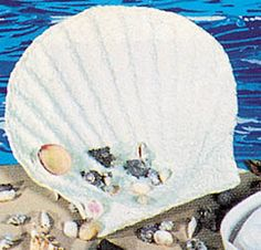 Use our Giant Paper Mache Shells to hold napkins at your underwater party.