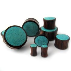 Pair of 1 Inch (25mm) Gauge Wood Plugs With Turquoise Stone Inlay - Double Flare UrbanBodyJewelry.com http://www.amazon.com/dp/B00GSE8HYI/ref=cm_sw_r_pi_dp_5kQqub00HMYF9