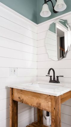 Paint your shiplap in a snap with this easy tutorial! Learn how to update your bathroom walls this winter, spring or summer with Zinsser PERMA-WHITE for a clean, bright, white look and protection from mold and mildew. Get a fresh farmhouse style for your bathroom, kitchen or entryway with white shiplap walls that will stay white for years to come.
