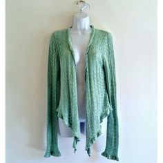 "$29. ($50 MRP.) NWT Aqua Mint Ruffled Angora Cardigan - Size L. Ultra soft angora wool blend! Brand new, unworn. Feminine and ruffled. Long draped sleeves. Prettiest cool aqua-mint color. So girly and cozy. Length - 24"" Size - L Label - Express Color may vary slightly based on screen display. #feminine #girly #softcardigan #drapedcardigan #drapedcardi #aqua #mint #mintgreen #ruffled #ruffles #ruffle #openfrontcardigan #opencardigan #opensweater #angorasweater #angora #angoracardigan"
