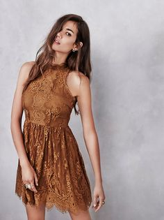Verushka Mini Dress | Delicate lace sleeveless mini dress featuring a mock neck and scalloped, eyelash lace trim. Sheer lace panel down the front bodice and buttondown detailing in back, with keyhole openings. Hidden side zip closure. Lined.