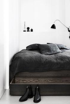Bedroom with dark bedframe with storage