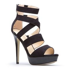 Dare to wear this tantalizing high-heel sandal, a towering beauty that'll give you legs for days.