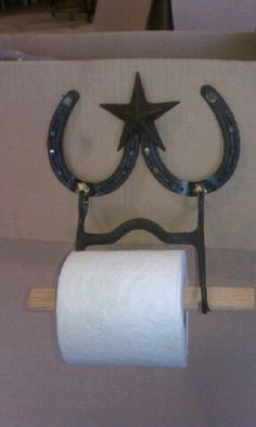 Toliet paper holder made of horse shoe's