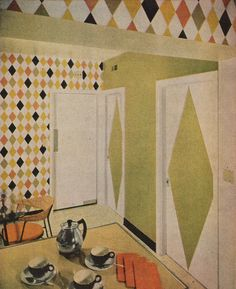 """""""Huge diamonds painted on doors are a sophisticated repeat of harlequin pattern wallpaper."""""""
