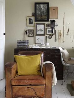 Vintage leather couch + mixed frames + necklaces on the wall