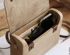 The Oak Wood Bag by Haydanhuya is handmade using one piece of oak wood and vegetable tanned leather. Its unique id will be written at the backside, and