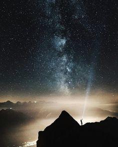 Epic stargazing. . . Credit: @dino.reichmuth .Oberried am Brienzersee Switzerland . #Switzerland #stargazing #stars #starrynight #galaxy #mountains #citylights #flashlight #nightphotography #nighttime #nightlights #silhouette