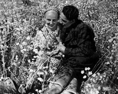 """A basic set up in finnish films: a girl in a national costume, a boy and a meadow full of flowers. Teuvo Tulio: Laulu tulipunaisesta kukasta (The Song Of The Flaming Red Flower). Actors in the photo Rakel Linnanheimo and Kaarlo """"Kille"""" Oksanen."""