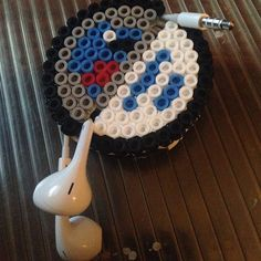 Star Wars earbud holder perler beads by orangeambu 3d Perler Bead, Perler Bead Templates, Pearler Bead Patterns, Perler Patterns, Melty Bead Designs, Headphone Holder, Art Perle, Beaded Banners, Nerd Crafts