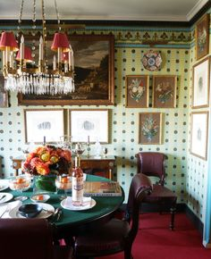 Jeffrey Bilhuber NYC Home: Everything about Jeffrey's design of the breakfast room is meant 'to coddle'. A mélange of porcelain plates, oil paintings and contemporary drawings are hung atop Mauny French 19th century block print pattern wallpaper.